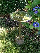 Vogeltränke wie antik- mit trinkendem Kolibri,