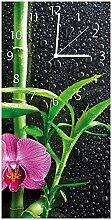 Wallario Design Wanduhr Bambus und Pinke Orchidee
