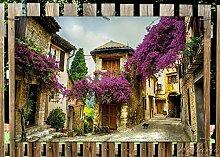 Wallario Garten-Poster Outdoor-Poster - Malerische Stadt in der Provence mit bunten Blumen in Premiumqualität, Größe: 61 x 91,5 cm, für den Außeneinsatz geeigne
