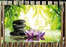 Wallario Garten-Poster Outdoor-Poster - Steinstapel in schwarz mit Blumenblüte in lila in Premiumqualität, Größe: 61 x 91,5 cm, für den Außeneinsatz geeigne
