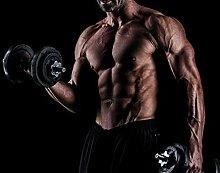 wandmotiv24 Fototapete Fitness Mann mit Hanteln
