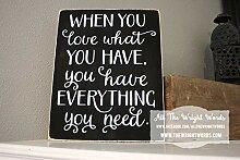 Wandtafel mit Aufschrift When You Love What You