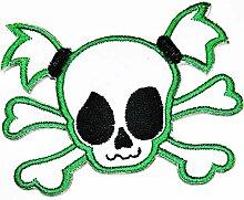 Weißer grüner Totenkopf und gekreuzte Knochen
